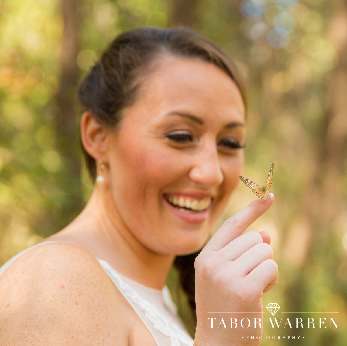 meadowlake-ranch-bride-with-butterfly-photographer.jpg